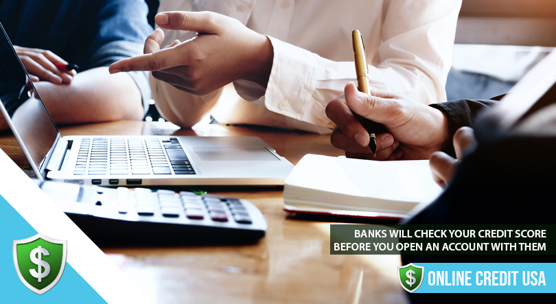 Bank managers meeting to discuss credit scores for opening new accounts